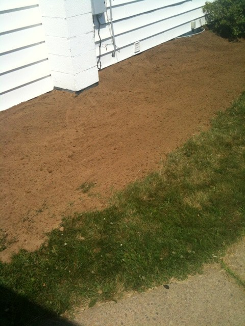 Yard grading 101 how to grade a yard for proper drainage for Yard drainage slope