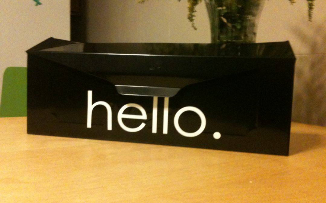 Black mailbox with the word hello in white.