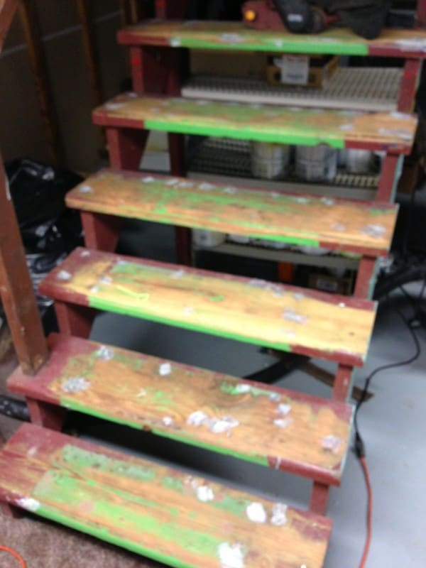 After sanding with a coarse grit, the steps started to look a little better. Check out the green slime paint they used to be before the red!