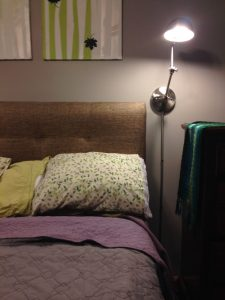 Wall lamps are a practical and stylish solution if you don't have a bedside table.