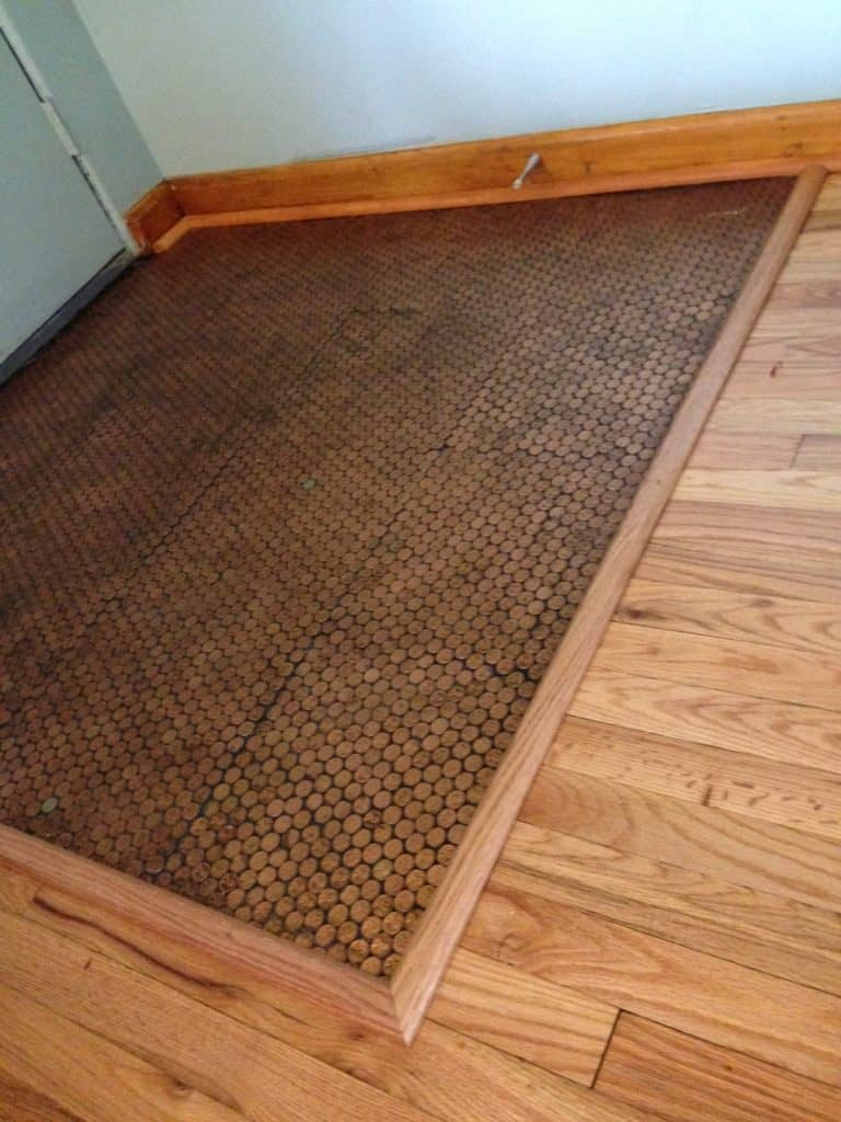 This is the penny floor with finished moldings and replaced boards. Where is the stain? It's like it never existed.