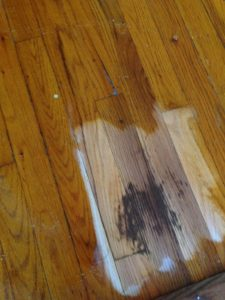 This is the stain after my pro sanded it, and then wet it down with a little bit of water. Not so subtle now, huh? Looks like this needs to be replaced.
