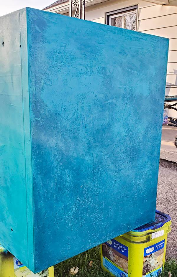 Top of filing cabinet with blue textured paint effect