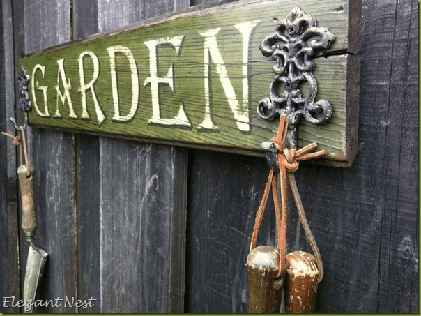 Green wood garden sign