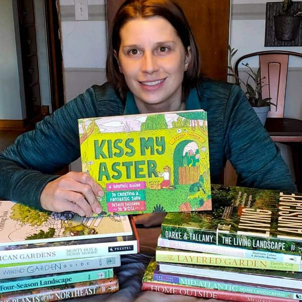 Amy Holding Kiss My Aster Gardening book
