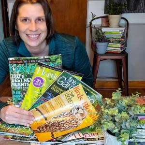 Amy holding all 4 gardening magazines