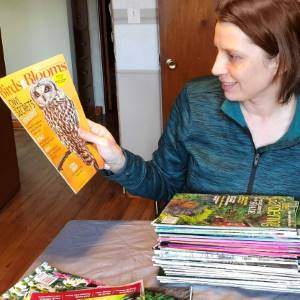 Amy reading Birds & Blooms Magazine