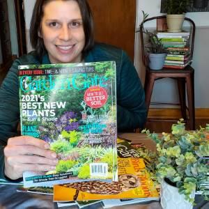 Amy reading Garden Gate Magazine