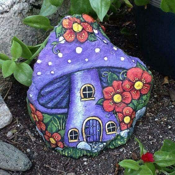 Purple mushroom house painted stone