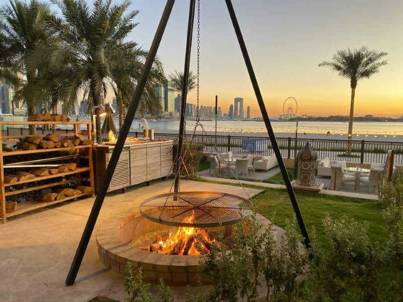 firepit and garden rooms with ocean backdrop in Dubai.