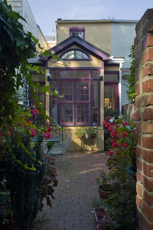 A two-toned purple front door in classic purple combined with deep grape.