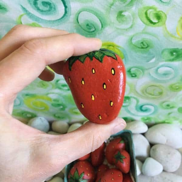 Strawberry painted garden stones