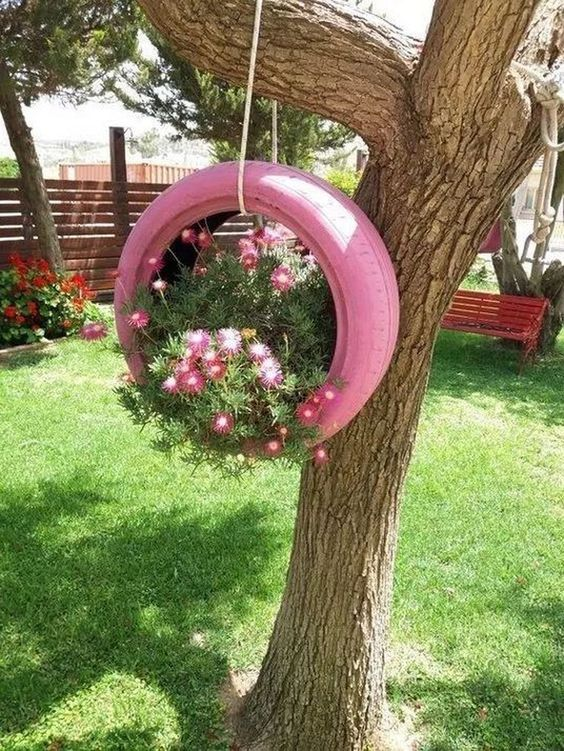 Pink tire swing planter