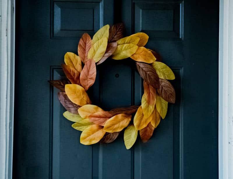 Yellow leaved wreath on navy door